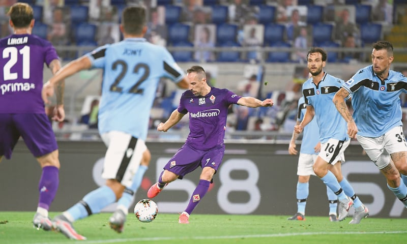 ROME: Fiorentina's Frank Ribery (C) shoots to score during the Serie A match against Lazio at the Stadio Olimpico.—Reuters