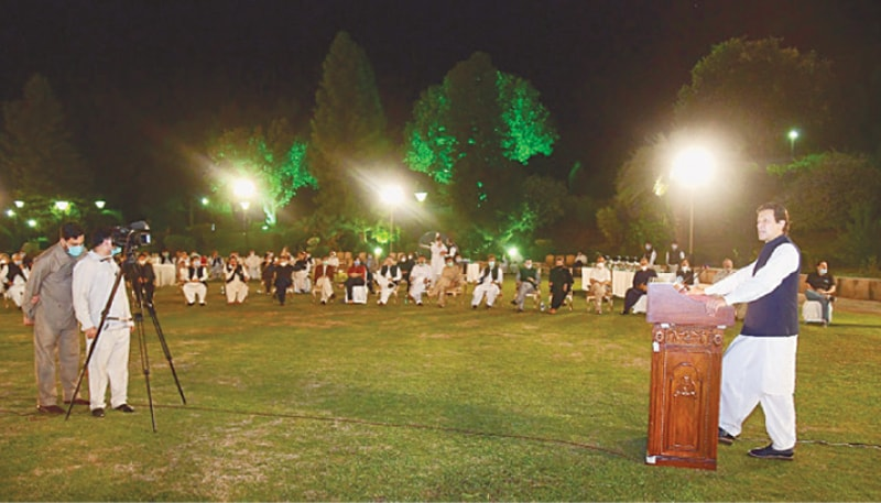 Prime Minister Imran Khan addresses participants of the reception on the lawns of PM House on Sunday.