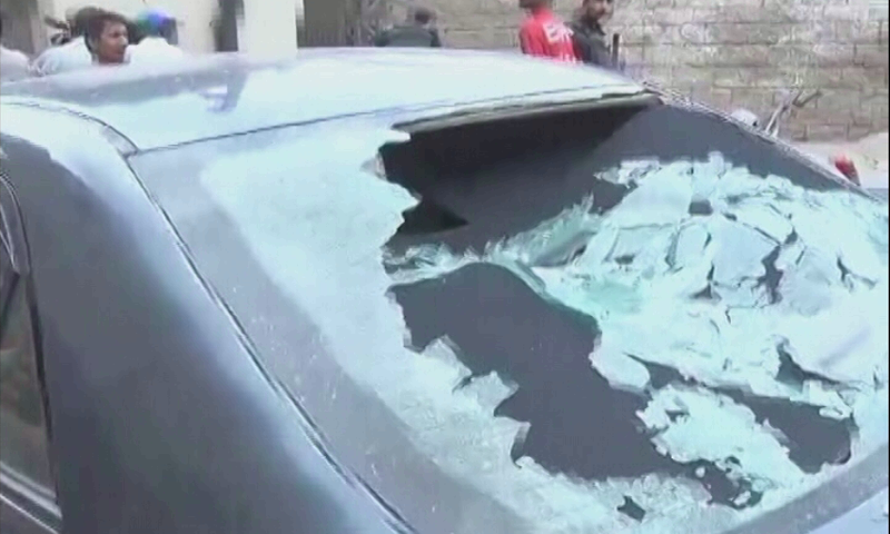 A damaged car seen near site of the attack. — DawnNewsTV