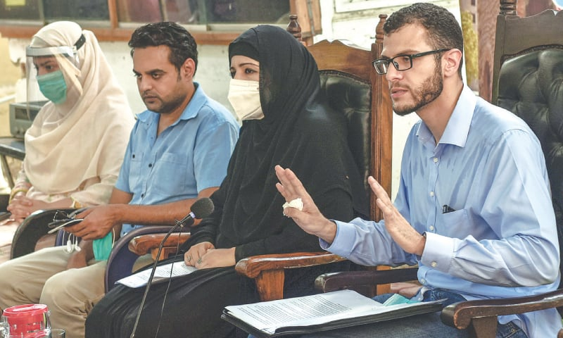 RELATIVES of the plane crash victims speak at the press conference at the Karachi Press Club on Monday. — White Star