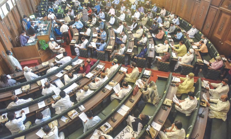 MAYOR Wasim Akhtar presides over the budget session of the Karachi Metropolitan Corporation on Monday.—Fahim Siddiqi / White Star