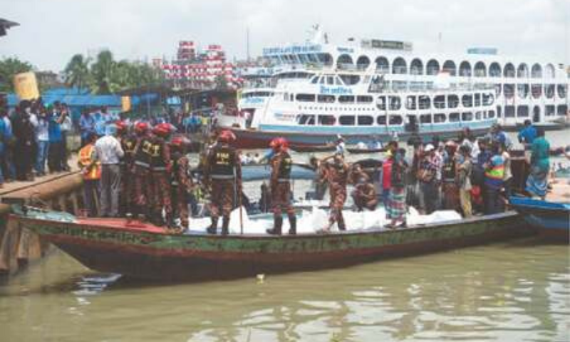 Dhaka: Rescue workers retrieve bodies of victims after a ferry capsized at Sadarghat ferry terminal on Monday. — AFP