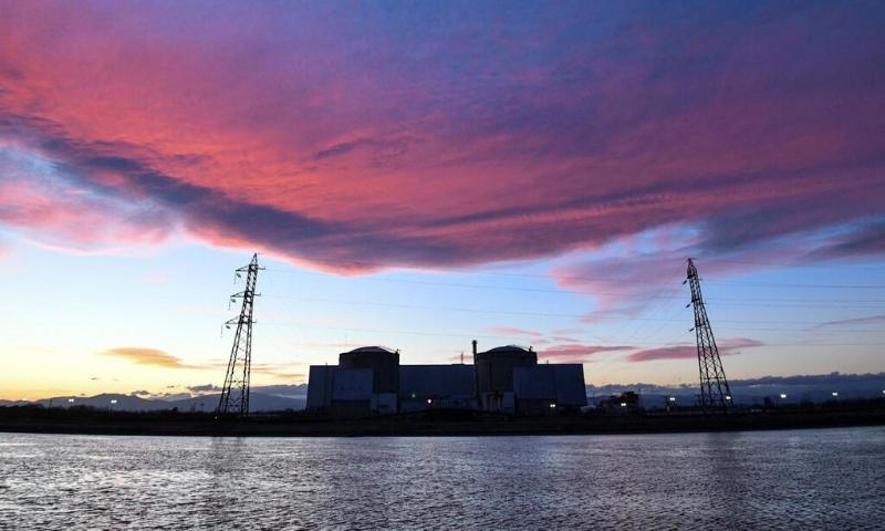 The sun is setting on the Fessenheim nuclear powerplant. — AFP/File