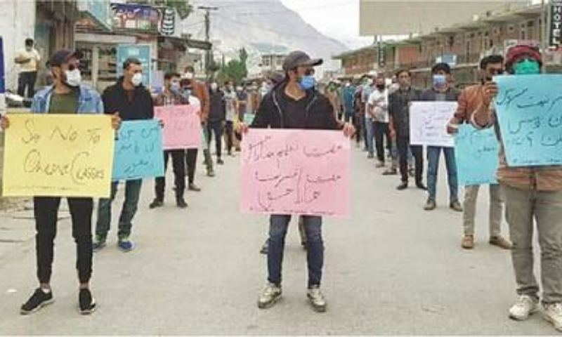 Students stage a protest on Karakoram Highway in Aliabad, Hunza, on Monday. — Dawn