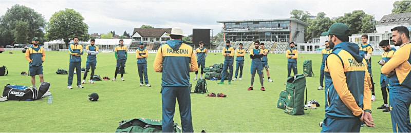WORCESTER: Head coach and chief selector Misbah-ul-Haq speaks to Pakistan cricket team players during their first practice session after arriving in England as captain Azhar Ali (second right) looks on.
