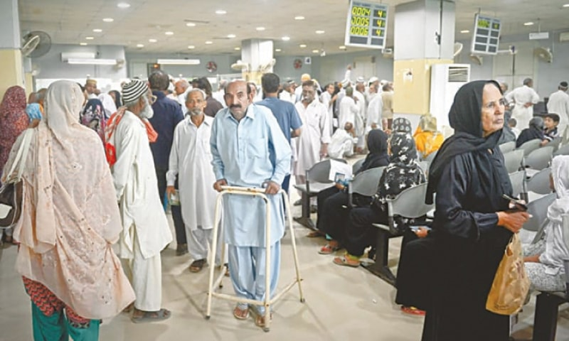 In this file photo, a large number of pensioners and investors are seen at a National Savings branch in Karachi.