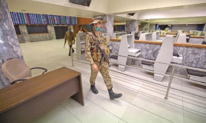 Army personnel secure the Pakistan Stock Exchange building on Tuesday, a day after the terrorist attack. — INP