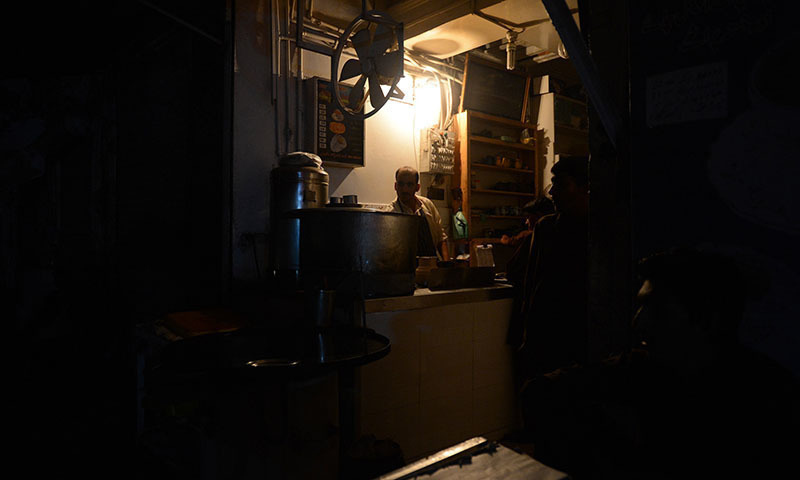 Hesco staff kept working till the evening to ensure restoration of power supply in various districts. — AFP/File