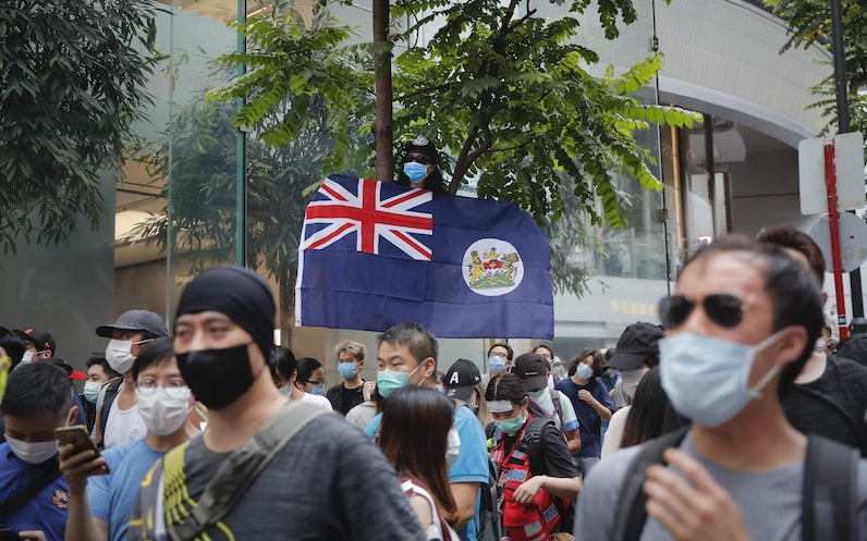 A man displays the Hong Kong colonial flag on the anniversary of Hong Kong's handover to China from Britain in Hong Kong, Wednesday, July. 1, 2020. Hong Kong marked the 23rd anniversary of its handover to China in 1997, and just one day after China enacted a national security law that cracks down on protests in the territory. — AP