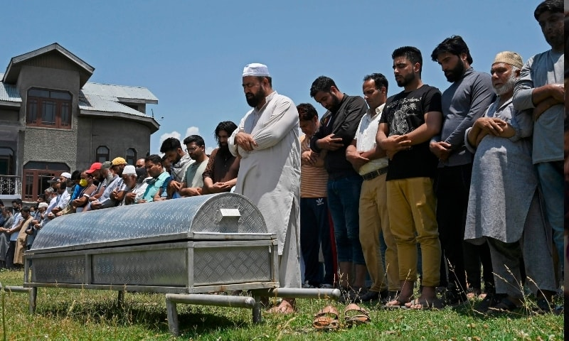 Relatives and neighbours offer funeral prayers for Bashir Ahmed in Srinagar on July 1. — AFP