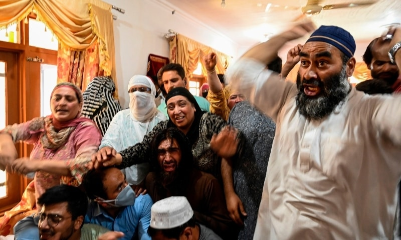 Relatives of civilian Bashir Ahmed Khan shout slogans as they grieve inside his residence on the outskirts of Srinagar on July 1. — AFP