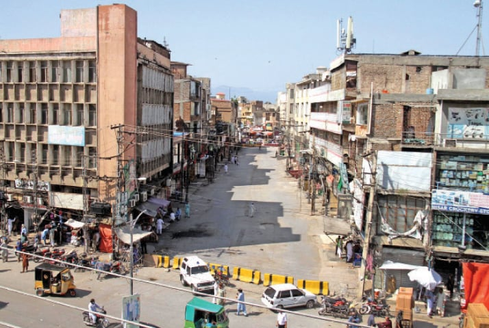 Bara Market in Rawalpindi wears a deserted look after lockdown was enforced on Wednesday to limit the spread of the coronavirus. — Photo by Mohammad Asim