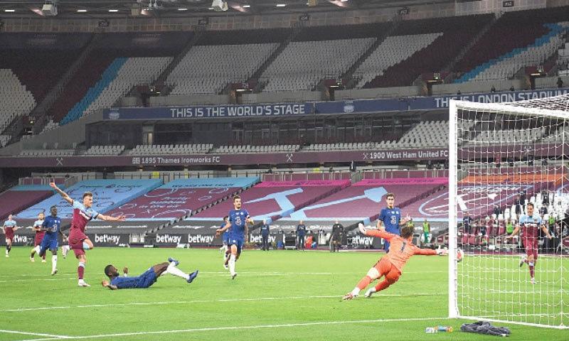 LONDON: West Ham United's Andriy Yarmolenko (L) scores the winning goal past Chelsea goalkeeper Kepa Arrizabalaga during their English Premier League match at The London Stadium.—AFP