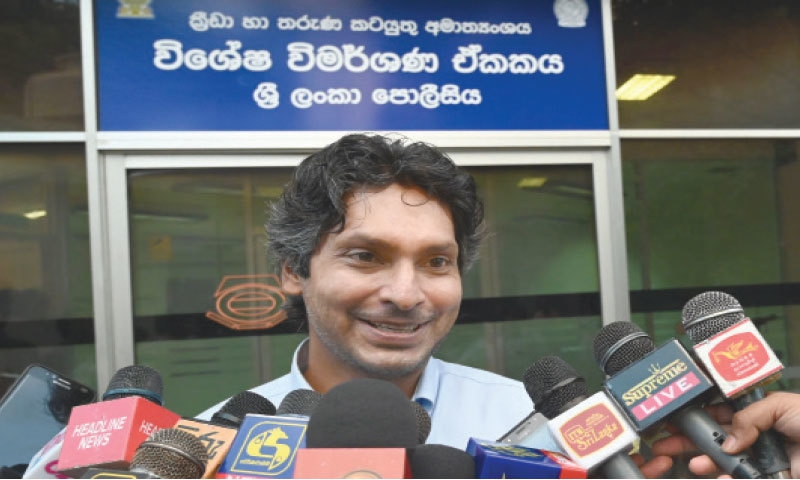 FORMER Sri Lankan captain Kumar Sangakkara speaks to the media after being questioned by police at the Special Investigation Unit on Thursday.—AFP