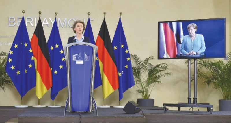 BRUSSELS: President of the European Commission Ursula von der Leyen (left) addresses a joint press conference with German Chancellor Angela Merkel at the start of the German presidency by video conference at the EU headquarters in Brussels on Thursday.—AFP