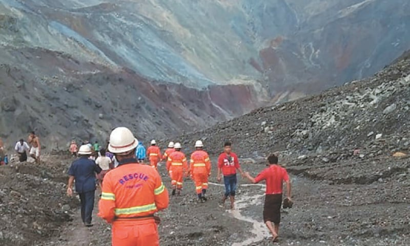 THIS handout picture shows rescuers attempting to locate survivors after the landslide—AFP