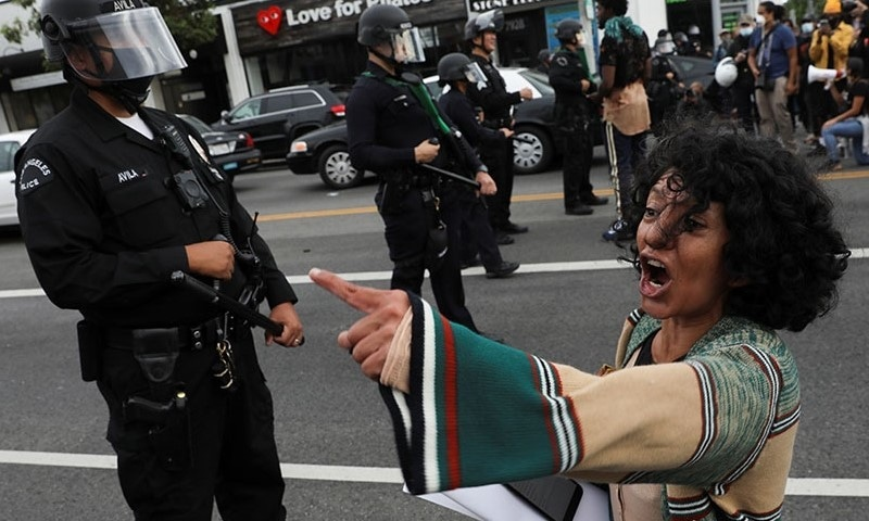 A woman gestures in front of police officers during a protest against the death in Minneapolis police custody of George Floyd, in Los Angeles, California. — Reuters