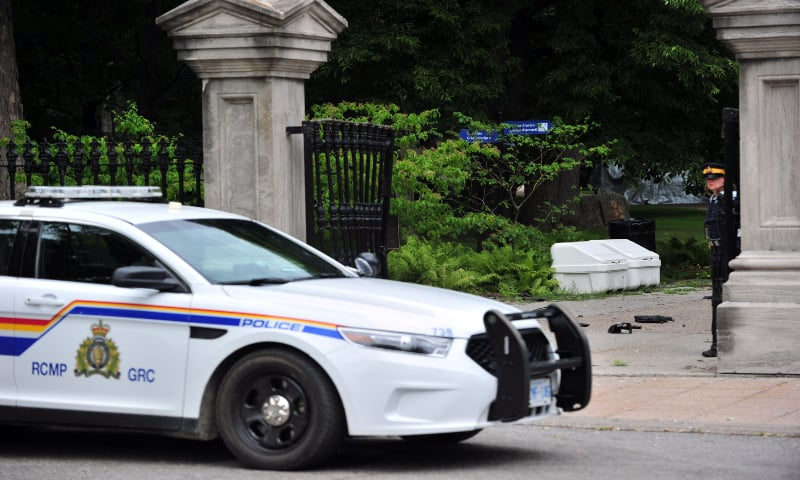 Canadian police stand guard outside Rideau Hall in Ottawa, Canada on July 2, 2020, after an armed man who entered the grounds was arrested in the property that is home to Prime Minister Justin Trudeau and the country's governor general. — AFP