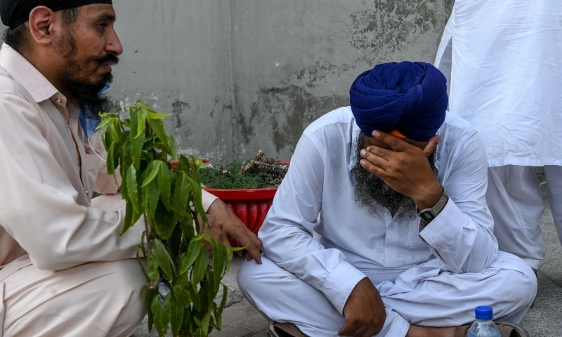 A Sikh man reacts after the death of a relative at a hospital following the accident in Sheikhupura. — AFP