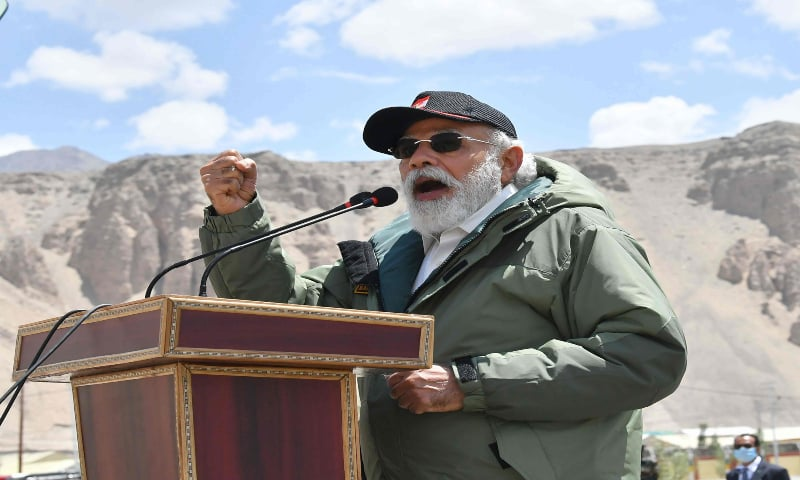 In this handout photograph taken on July 3, 2020 and released by the Indian Press Information Bureau (PIB), India's Prime Minister Narendra Modi gestures as he speaks to Indian troops during his visit to Nimu in the union territory of Ladakh. — AFP