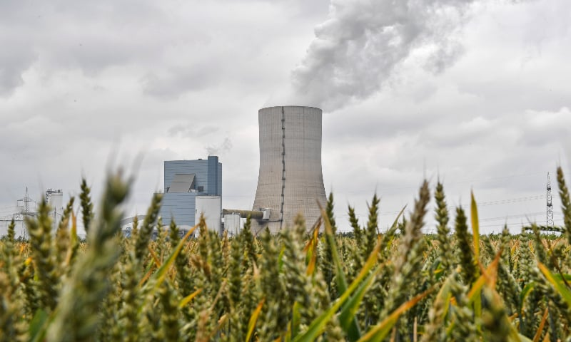 The controversial most modern Uniper Datteln 4 coal-powered plant steams behind a corn field one month after the operational start in Datteln, Germany, Friday, July 3, 2020. — AP