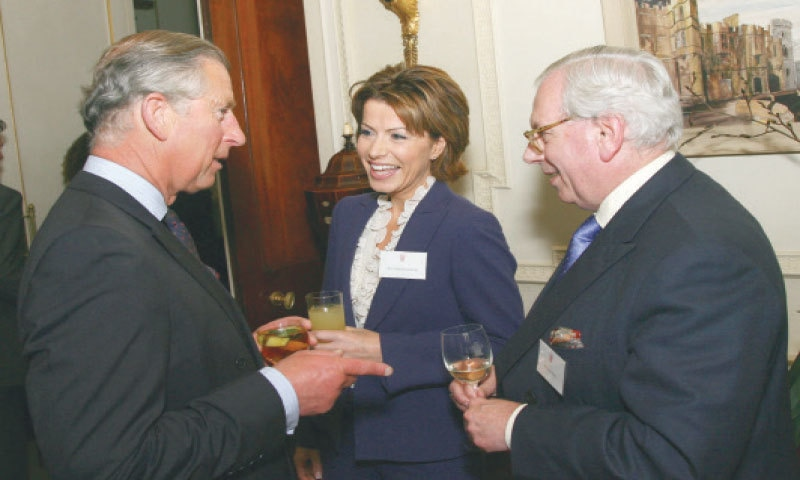 This May 22, 2007 file photo shows Prince Charles speaks with Natasha Kaplinsky and David Starkey (right) during a reception hosted by the Prince and his wife, Camilla, for the Royal Television Society at Clarence House.— AFP