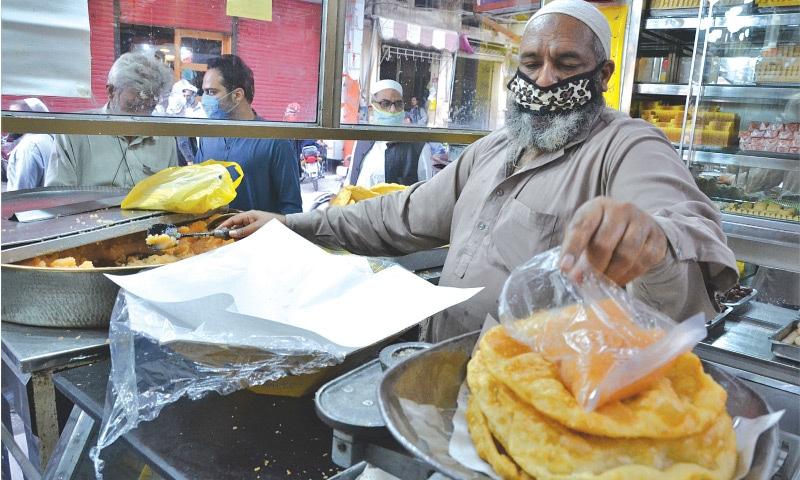 A shopkeeper sells halwa puri in Namak Mandi, Peshawar | Shahbaz Butt/White Star