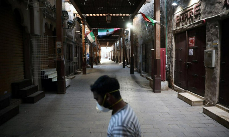 A man wearing a protective face mask walks through the deserted Barajeel Souq, following the outbreak of the coronavirus disease, in old Dubai, United Arab Emirates in March. — Reuters
