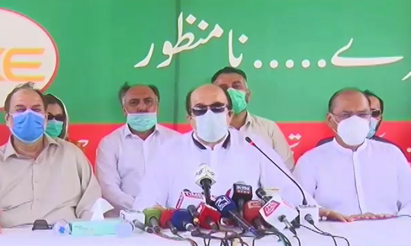 PTI lawmakers speaking at a press conference in Karachi on Sunday. — DawnNewsTV
