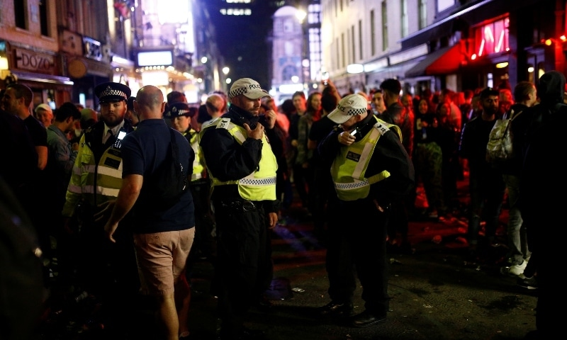 Police on patrol as people gather in Soho as restrictions are eased following the outbreak of the coronavirus disease in London on July 4. — Reuters