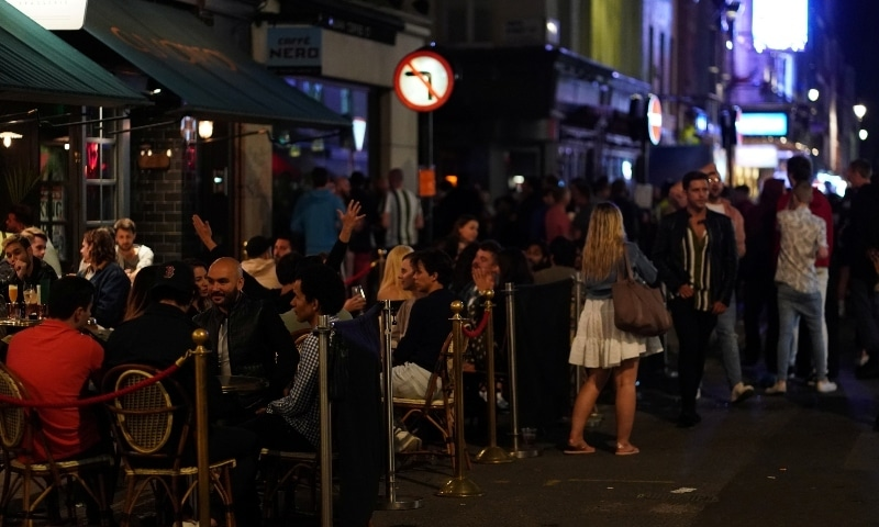 People gather in Soho as restrictions are eased following the outbreak of the coronavirus disease in London on July 4. — Reuters