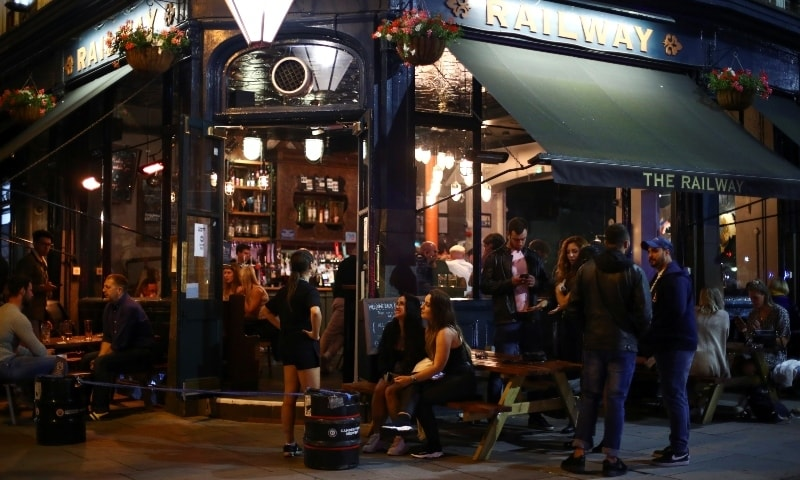 A general view shows people at a bar in Clapham, after the reopening of commercial activities following the outbreak of the coronavirus disease, in London. — Reuters