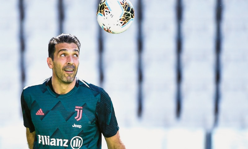 TURIN: Juventus goalkeeper Gianluigi Buffon keeps his eyes on the ball prior to the Serie A match against Torino, during which he set an outright record with his 648th appearance in Italy's top flight.—AP