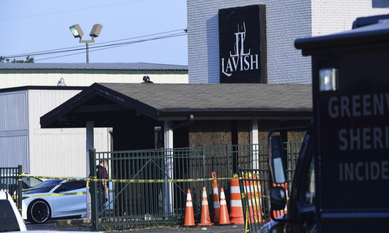 Yellow police tape can be seen outside of the Lavish Lounge in Greenville, S.C., Sunday, July 5, 2020, following a deadly shooting. — AP