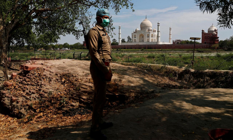 A policeman wearing a protective mask stands guard near the historic Taj Mahal during a nationwide lockdown to slow the spread of Covid-19, in Agra, India in April. — Reuters/File
