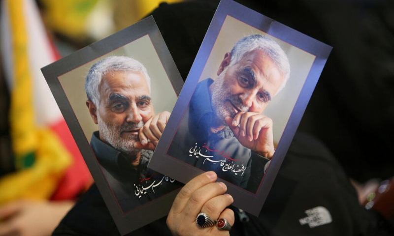 A supporter of Lebanon's Hezbollah leader Sayyed Hassan Nasrallah carries pictures of the late Iran's Quds Force top commander Qassem Soleimani during a rally commemorating the annual Hezbollah's slain leaders in Beirut's southern suburbs, Lebanon. — Reuters/File