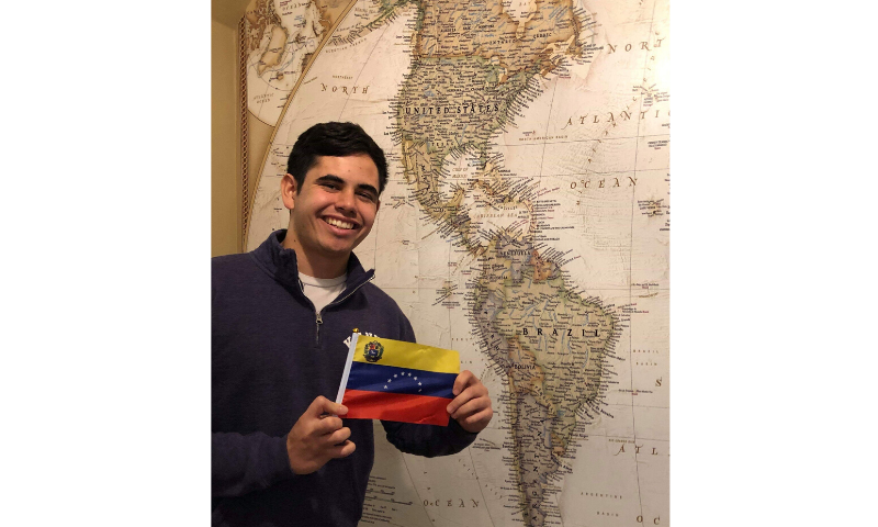 Raul Romero holds a Venezuelan flag as he poses for a photo at Kenyon College in Gambier, Ohio, US on February 2, 2020. — Reuters/File