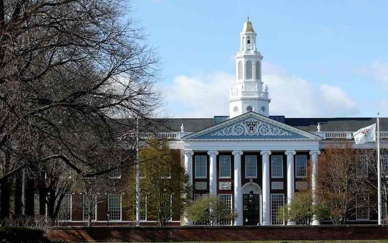 In this file photo a general view of Harvard University campus is seen on April 22, 2020 in Cambridge, Massachusetts. Harvard and MIT asked a court on July 8, 2020 to block an order by President Donald Trump's administration threatening the visas of foreign students whose entire courses have moved online because of the coronavirus pandemic. — AFP/ File