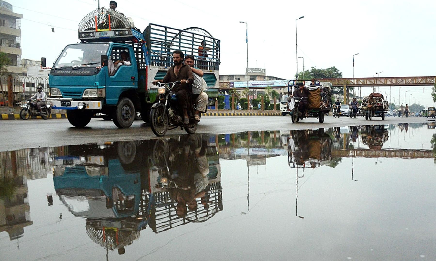 A view of stagnant water on a road after rain in Karachi on Wednesday. — APP