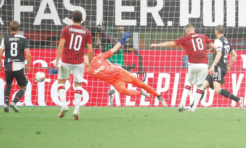 MILAN: AC Milan's Ante Rebic (second right) scores during the Serie A match against Juventus at the San Siro.—AP