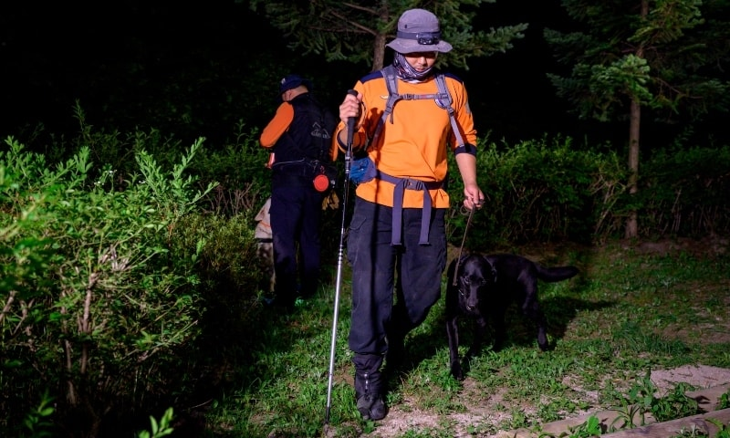 Search and rescue teams prepare to search Waryong park for Seoul mayor Park Won-soon, who was last seen there and was reported missing earlier in the day, in Seoul. — AFP