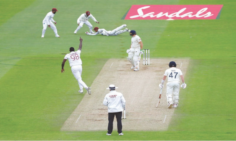 SOUTHAMPTON: West Indies' wicket-keeper Shane Dowrich dives to take the catch to dismiss England batsman Joss Buttler during the first Test at the Ageas Bowl on Thursday.—AP