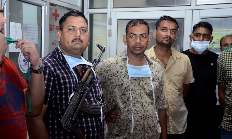 Police officers stand guard at a hospital where the body of top criminal Vikas Dubey is being kept, in Kanpur on July 10. — AP