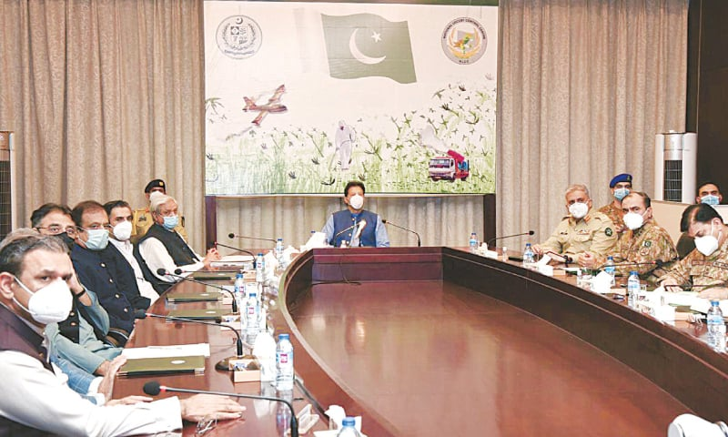 ISLAMABAD: Prime Minister Imran Khan chairs a meeting at the National Locust Control Centre on Friday.
