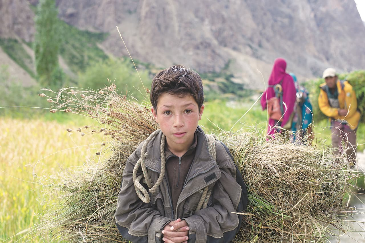 A local boy pauses farm work to smile for the camera | Amna Zuberi