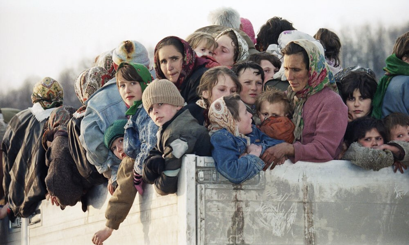 In this Monday, March 29, 1993 file picture evacuees from the besieged Muslim enclave of Srebrenica, packed on a truck en route to Tuzla, pass through Tojsici. — AP