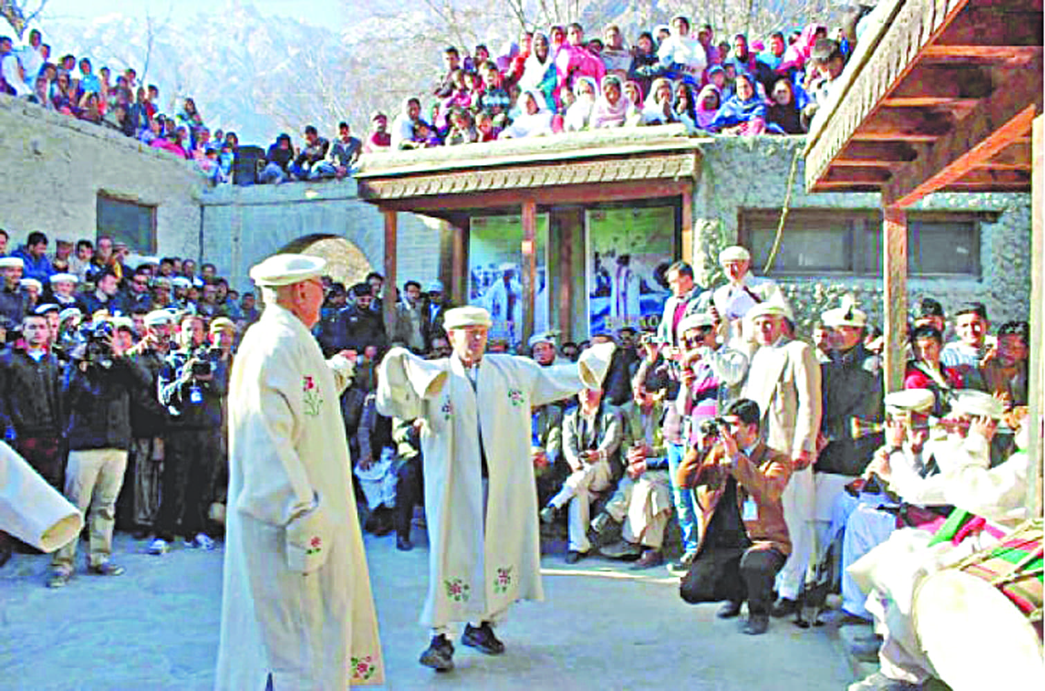 Locals and foreign tourists watch a traditional dance at a festival in Hunza | File