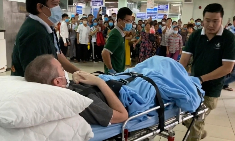 A British pilot who was Vietnam's most critical Covid-19 patient is carried on a stretcher in Ho Chi Minh City, Vietnam, Saturday. — AP