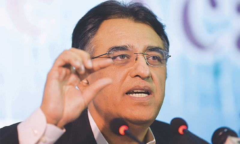 Asad Umar said that collective efforts of the people were needed to contain the virus by following the SOPs. — AFP/File