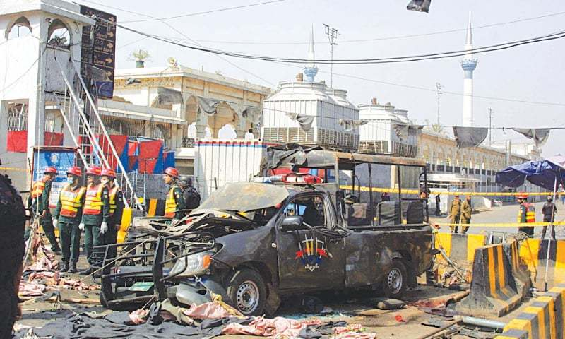 A file photo of the mangled remains of the police van after the suicide attack outside Data Darbar. — PPI
